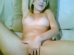 Kinky amateur video of a naked blonde cutie playing with her moist cunt on webcamvideo
