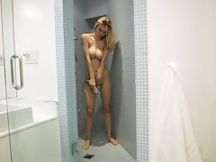 Big breasted blonde Natalia Star gets naughty in the shower aiming the spray at her craving pussy for maximum pleasurevideo